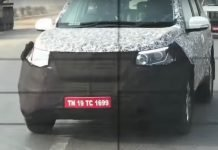 2018-Mahindra-XUV500-facelift-spied-front-three-quarters